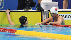 JAKARTA, Aug. 24, 2018  Wang Jianjiahe (R) of China shakes hands with another contestant after women's 400m freestyle final of swimming at the 18th Asian Games in Jakarta, Indonesia, Aug. 24, 2018. Wang won the gold medal. (Credit Image: © Pan Yulong/Xinhua via ZUMA Wire)