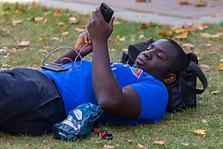 Prolific anti-Brexit campaigner Femi Oluwole takes a break from media interviews in the media encampment on College Green outside the Palace of Westminster as Parliament debates a move by MPs to get an extension to Article 50 rather than allowing the Government to leave the EU without a deal on October 31st. London, September 04 2019.