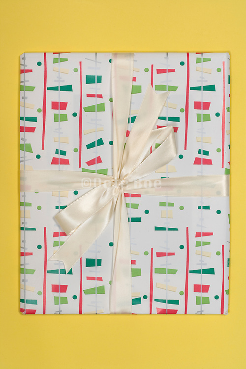 gift wrapped present with a white ribbon