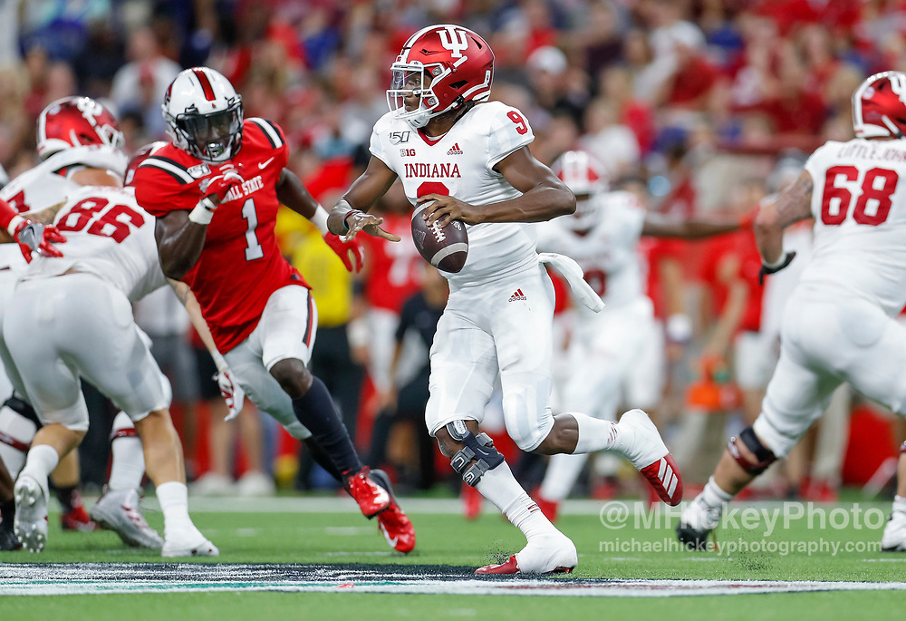 INDIANAPOLIS, IN - AUGUST 31: Michael Penix Jr. #9 of the Indiana Hoosiers drops back to pass during the game against the Ball State Cardinals at Lucas Oil Stadium on August 31, 2019 in Indianapolis, Indiana. (Photo by Michael Hickey/Getty Images) *** Local Caption *** Michael Penix Jr.