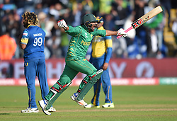 Pakistan captain Sarfraz Ahmed celebrates hitting the winning runs during the ICC Champions Trophy, Group B match at Cardiff Wales Stadium.