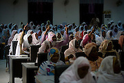 Ladies attending the first-ever international Conference on Womens' Challenge in Darfur, gather in a compound belonging to the Govenor of North Darfur in Al Fasher (also spelled, Al-Fashir) where the women from remote parts of Sudan gathered to discuss peace and political issues.