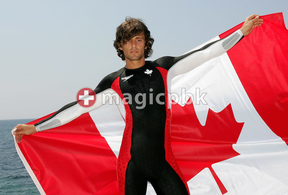 A model presents the swimsuit of Canada's olympic swimming team during a photocall at the Olympic Games 2004 in Athens, Monday 09 August 2004. (Photo by Patrick B. Kraemer / MAGICPBK)