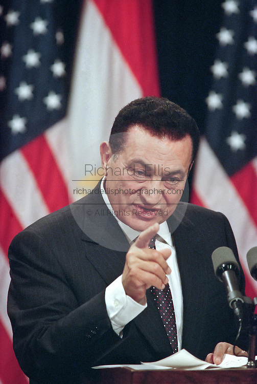 Egyptian President Hosni Mubarak answers a question during a joint press conference at the White House, July 1, 1999. The two leaders met privately behind closed doors looking for a lasting peace solution in the Middle East.