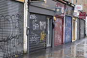 With shutters closed, all the shops are shut down along Wentworth Street adjacent to the famous Petticoat Lane a market area of the City of London, which is deserted due to the Coronavirus pandemic as the national lockdown three continues on 29th January 2021 in London, United Kingdom. Following the surge in cases over the Winter including a new UK variant of Covid-19, this nationwide lockdown advises all citizens to follow the message to stay at home, protect the NHS and save lives.