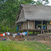A Yanayacu Indian family in San Juan de Yanayacu, a village in the Peruvian Amazon, relaxes in their hut.