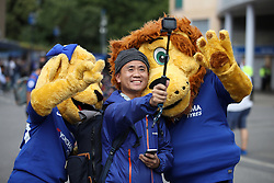 A Chelsea supporter takes selfie outside Stamford Bridge witht the Chelsea mascots before the Premier League match at Stamford Bridge, London.