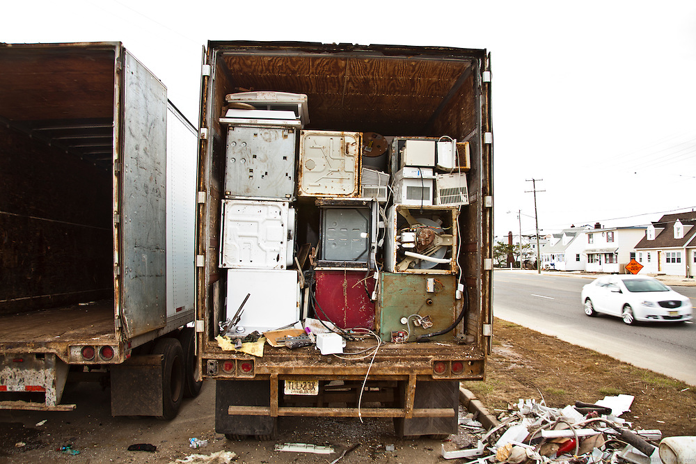On Long Beach Island three trailers await their cargo of metal appliances damaged by the storm.