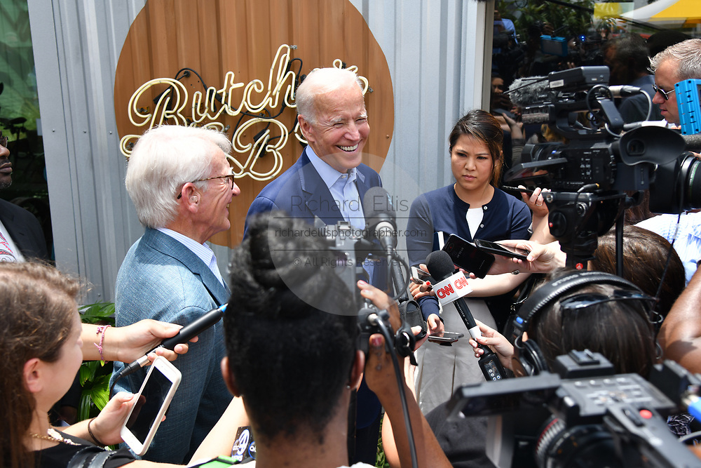 Democratic presidential hopeful former Vice President Joe Biden, center, smiles during a press briefing with former Charleston Mayor Joe Riley, left, before a lunch with local officials at the Butcher and Bee July 7, 2019 in Charleston, South Carolina. Riley, mayor of the city for 42-years has endorsed the former Vice President.