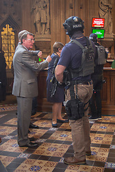 © Licensed to London News Pictures.22/03/2017. London, UK. Former Northern Ireland First Minister David Trimble stands near an armed policeman in the Central Lobby  during a lockdown in Parliament after a terrorist attack in Westminster.Photo credit: Alison Baskerville/LNP<br />