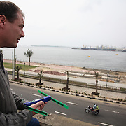 Electronic waste export to Nigeria..It has been confirmed that the TV is in the Tin Can Port of Lagos and that the container has moved since arrival.  Eric Albertsen is trying to pick-up radio signals omitting from the tracker device in the TV, but with no luck.  ..The shipment - TV-set originally delivered to municipality-run collecting point in UK for discarded electronic products - was tracked and monitored by Greenpeace using a combination of GPS (Global Positioning System using satellites), GSM (positioning using data from mobile networks to triangulate approximate positions) and an onboard radiofrequency transmitter (used for making triangulations in combination with handheld directional receivers used by team on ground) is placed inside the TV-set.  The TV arrived in Lagos in container no 4629416..