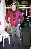 Philip Baldwin watching John Galea performing  festive songs at the Yamaha Store in Soho, London.