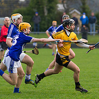 Cratloe's Cathal O'Connell tackled  by Cratloe's David Collins