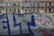 Graffiti and tags on a screen at the De Guesclin tram stop in Montpellier, south of France.