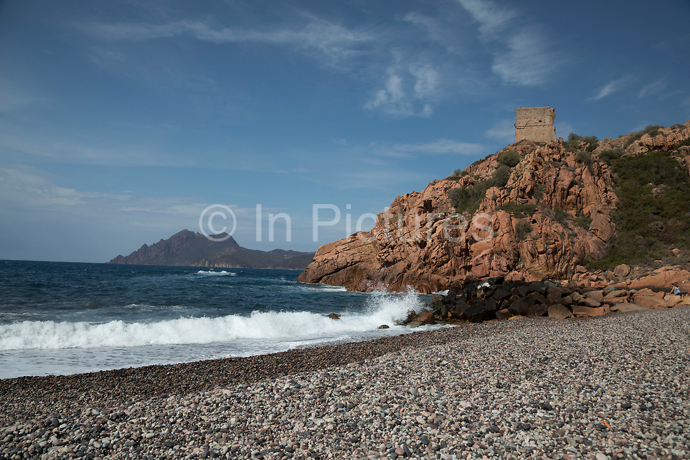 Genoese tower at Porto, a west coast village overlooking the Golfe de Porto, a tourism destination built for that specific reason. It is essentially, a port for tourist boats to moor and leave from and a series of hotels, restaurants and attractions around the beach on 15th September 2017 in Corsica, France.