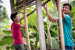 14 September 2018, Damak, Nepal: Two young men work on constructing a house in the Beldangi refugee camp in the Jhapa district of Nepal, which hosts more than 5,000 Bhutanese refugees. On 12-19 September 2018, the Lutheran World Federation General Secretary Rev. Dr Martin Junge visits Nepal. He will participate in the 75th anniversary celebrations of the Nepal Evangelical Lutheran Church, an LWF member church, and visit development projects run by the church. He will also visit the LWF country program, which is involved in humanitarian relief and development work in a range of areas, supporting refugees, offering relief work to those most affected by the 2015 earthquake, flood victims, among other projects.