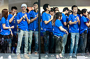 Apple Inc. employees line up inside in anticipation of  the official opening of the company's new store in Shanghai, China, on Friday, Sept. 23, 2011. Apple Inc. is currently has 5 stores in mainland China as it struggles to open enough stores to stave off competition of its popular iPhones and iPads