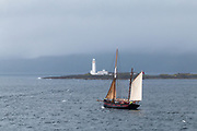 """""""Leader""""; Brixham Sailing Trawler.  Leader looks like a Gaff rigged ketch.  She was built in 1892.  Here she is passing Eilean Musdile Lighthouse in Scotland between the Isl of Mull and the city of Oban."""
