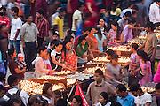 Crowds of worshipers light butter lamps in ritual offering during Buddha Jayanti (Buddha's birthday) at Boudhanath Stupa, Kathmandu, Nepal on May 9, 2009.