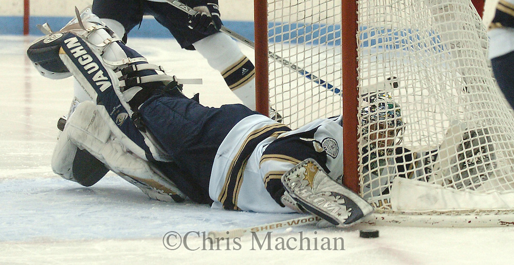 2/9/07 Omaha , IN   University of Notre Dame goalie David Brown reaches from inside the net to scoop up a puck at the Joyce Center.(Chris Machian/Prairie Pixel Group)..