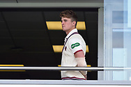 Tom Abell of Somerset looks out from the team balcony during the rain delay during the Specsavers County Champ Div 1 match between Somerset County Cricket Club and Essex County Cricket Club at the Cooper Associates County Ground, Taunton, United Kingdom on 26 September 2019.