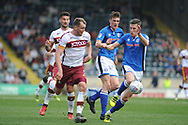 Bradford City forward, and new signing,  Kai Bruenker (21)  and Rochdale Defender, Jim McNulty (4)  during the EFL Sky Bet League 1 match between Rochdale and Bradford City at Spotland, Rochdale, England on 21 April 2018. Picture by Mark Pollitt.