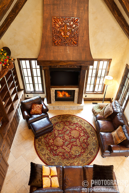 This was shot for the artist who applied the venetian plaster to the walls, antiqued the fire place chimney, and created the faux wood beams by hand.