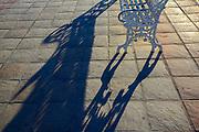 Bench shadow along the Malecon, evening light, February, La Paz, Baja, Mexico