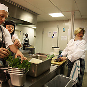 Helena Puolakka, Executive Chef at the Skylon, Royal Festival Hall in London...Helena Puolakka preparing grouse for tonight's dinner while while chattinga and laughing with staff.