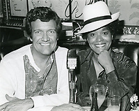 1978 Radio commentator/interviewer, Gregg Hunter is seen interviewing Emily Yancy during his KIEV radio show at the Hollywood Brown Derby Restaurant, on Vine St.