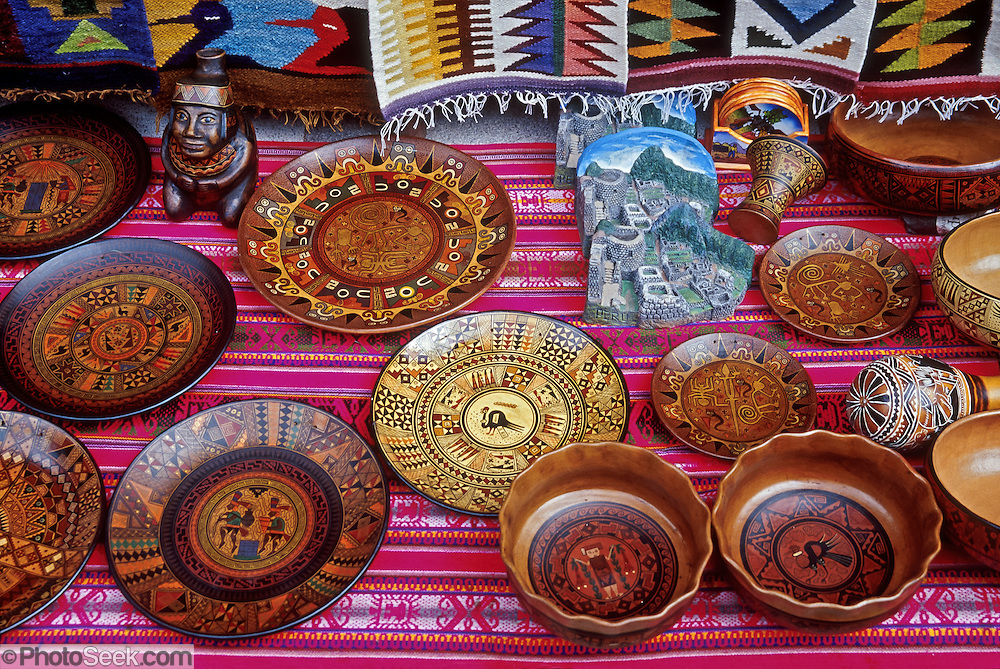 """Carved and decorated wood Andean plates are sold at Aguas Calientes village (""""Machupicchu Town"""") at the foot of Machu Picchu, in Peru, South America."""