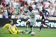 Bafetimbi Gomis of Swansea city beats Newcastle goalkeeper Tim Krul and scores his teams 1st goal. Barclays Premier League match, Swansea city v Newcastle Utd at the Liberty Stadium in Swansea, South Wales on Saturday 15th August  2015.<br /> pic by Andrew Orchard, Andrew Orchard sports photography.