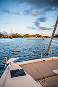 Colorful sunset approach to the mooring field in Bourg de Saintes aboard a Bali 40 catamaran