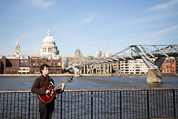© Licensed to London News Pictures. 23/03/2020. LONDON, UK. A musician busks on a quiet South Bank this afternoon. The government has advised people to practice social distancing measures that help reduce the transmission of Coronavirus (COVID-19). Photo credit: Luke Dray/LNP