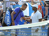 Tennis - 2017 Aegon Championships [Queen's Club Championship] - Day One, Monday<br /> <br /> Men's Singles, Round of 32<br /> Nick Kyrgios [Aus] vs. Donald Young [USA]<br /> <br /> Nick Kyrgios comes round the net to Donald Young after retiring through injury on Centre Court.<br /> <br /> COLORSPORT/ANDREW COWIE