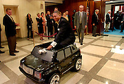 TALLAHASSEE, FL. 5/5/06-House Democratic leader Chris Smith, D-Fort Lauderdale drives a miniature Cadillac Escalade out of the House Chamber after fellow democrats gave him the car, Friday at the Capitol in Tallahassee. Members of the House gave Speaker Allan Bense, R-Panama City, a 1997 Corvette to thank him for his service, the Democratic caucus is not as large, or well funded, so the battery powered caddy had to do. COLIN HACKLEY PHOTO