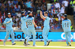 England's Chris Woakes (centre) celebrates taking the wicket of K. L. Rahul (not pictured) during the ICC Cricket World Cup group stage match at Edgbaston, Birmingham.