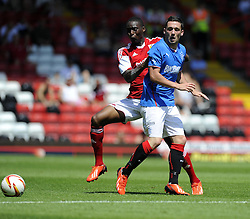 Bristol City's Jordan Wynter battles for the ball with Glasgow Rangers' Nicky Clark - Photo mandatory by-line: Joe Meredith/JMP - Tel: Mobile: 07966 386802 13/07/2013 - SPORT - FOOTBALL - Bristol -  Bristol City v Glasgow Rangers - Pre Season Friendly - Bristol - Ashton Gate Stadium