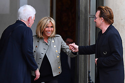 Singer Bono of Irish band U2 and co-founder of ONE organization and Brigitte Macron, wife of the French President pose at the Elysee Palace in Paris, France, July 24, 2017. Photo by Christian Liewig/ABACAPRESS.COM.