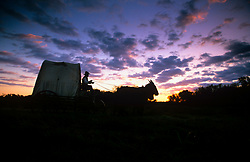 Silhouette of a trail rider at dusk
