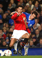 Fotball<br /> Foto: SBI/Digitalsport<br /> NORWAY ONLY<br /> <br /> Carling Cup Semi Final first leg<br /> <br /> Chelsea v Manchester United. 12/1/2005.<br /> <br /> Chelsea's Joe Cole and Manchester United's Christiano Ronaldo