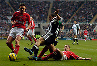 Fotball<br /> England 2004/2005<br /> Foto: SBI/Digitalsport<br /> NORWAY ONLY<br /> <br /> Newcastle United v Charlton Athletic, Barclays Premiership, 05/02/2005.<br /> <br /> Newcastle's Kieron Dyer goes down in the box following a tackle by Charlton's Chris Perry as Newcastle become increasingly desperate in the closing stages of the game.