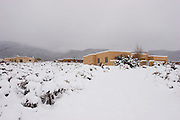Adobe homes in winter, Taos, New Mexico