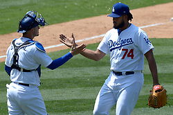 June 7, 2017 - Los Angeles, California, U.S. - Los Angeles Dodgers relief pitcher Kenley Jansen (74) high fives catcher Yasmani Grandal (9) after defeating the Washington Nationals during a Major League baseball game at Dodger Stadium on Wednesday, June 7, 2017 in Los Angeles. (Photo by Keith Birmingham, Pasadena Star-News/SCNG) (Credit Image: © San Gabriel Valley Tribune via ZUMA Wire)