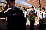 09 DECEMBER 2011 - PHOENIX, AZ:  1st Lt. MATTHEW KARNES salutes while laying a Christmas wreath on a veteran's grave in Phoenix. Several hundred volunteers and veterans gathered at the National Memorial Cemetery of Arizona in Phoenix Saturday to lay Christmas wreaths on headstones, a tradition started by Wreaths Across America. Wreaths Across America is a nonprofit organization founded to continue and expand the annual wreath laying ceremony at Arlington National Cemetery begun by Maine businessman, Morrill Worcester, in 1992.   PHOTO BY JACK KURTZ