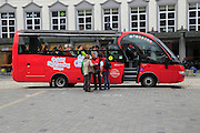 Red sightseeing bus in city of Bergen, Norway