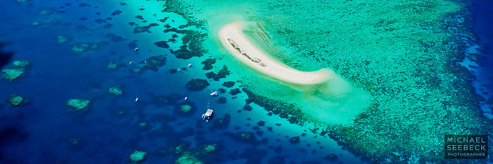 An aerial photograph of Michaelmas Cay on the Great Barrier Reef.<br /> <br /> Open Edition print