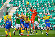 Elliot Parish (#12) of St Johnstone FC jumps to punch clear a Hibs cross ball during the SPFL Premiership match between Hibernian and St Johnstone at Easter Road Stadium, Edinburgh, Scotland on 1 May 2021.