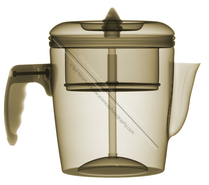 This is an antique aluminum coffee percolator. The x-ray shows the internal structures that allow the flow of water to extract the coffee flavors and percolate on a heat source.