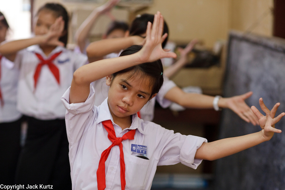Mar. 10, 2009 -- VIENTIANE, LAOS: Girls learn traditional Lao dance during an after class session in  an elementary school in Vientiane, Laos. Traditional Lao dance is closely related to Classical Thai and Khmer dance.   Photo by Jack Kurtz / ZUMA Press